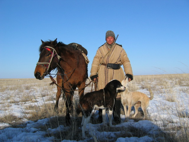 Kazakh_shepard_with_dogs_and_horse.jpg